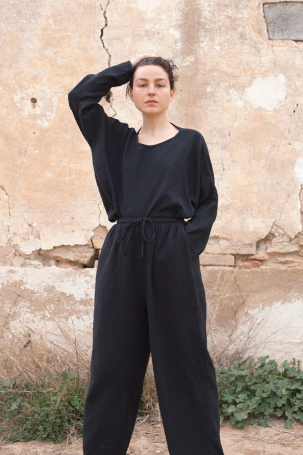 model is wearing the oli top paired with the oli pants both in black color