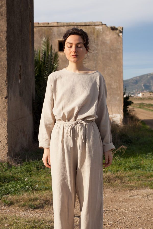model is wearing the oli top paired with the oli pants both in stone color