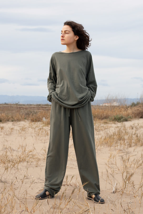 model is wearing the pina sweathsirt paired with the pina pants both in olive color