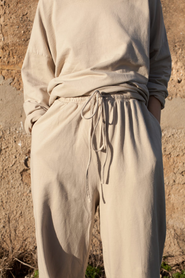 Detail of the model wearing the pina pants in stone